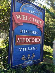 Sign that reads Welcome to Historic Medford Village